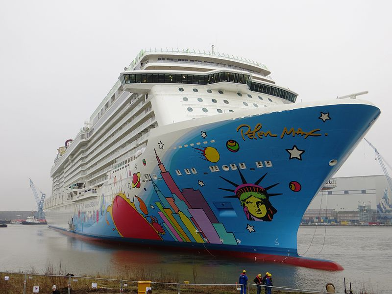 Sporting the pop art of Peter Max on its hull, the Norwegian Breakaway launched in May. (Dickelbers-Wikimedia)